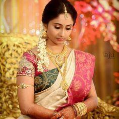 South Indian bride. Temple jewelry. Jhumkis.Cream silk kanchipuram sari with contrast blouse.Braid with fresh flowers. Tamil bride. Telugu bride. Kannada bride. Hindu bride. Malayalee bride