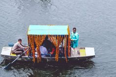 The unconventional destination wedding baraat reception in a boat from the lakeside to the mandap decorated with marigold flowers for this colourful Indian Wedding   Jonathan & Subhashree   Cureated by Witty Vows