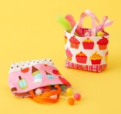 Stitch two fat quarter pieces into a quartet of mini totes. These wee gift bags have grosgrain ribbon handles.