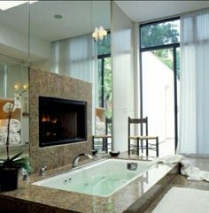 bathtub infront of fire place
