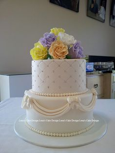 2-tier wedding cake, quilted and swags with sugar roses by Lena's Cake Design. Website and Blog: http://lenatambo.blogspot.com