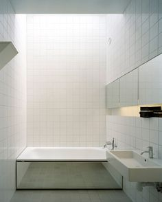 To minimalistic for me, but I adore the mirrored bath.