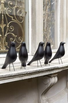 love these plus the incredibly beautiful iron work on in the windows.  eames house birds?