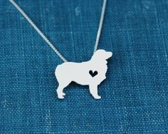"This tiny Australian Shepherd necklace is a perfectly delicate way to keep a loved pet close to your heart. Just ⅝"" at its largest dimension, our"