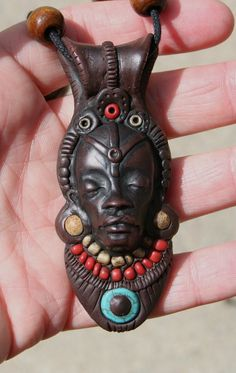 Ancient Faces-  One of A Kind polymer clay Tribal Adorned Face Pendant- Blue, Red, and Gold- Africa Inspired