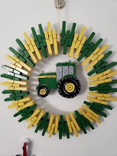 John Deere Clothespin Wreath Wreath Crafts, Craft Stick Crafts, Diy Wreath, Crafts For Kids, Diy Crafts, Door Wreaths, Craft Ideas, Wooden Clothespin Crafts, Wooden Clothespins