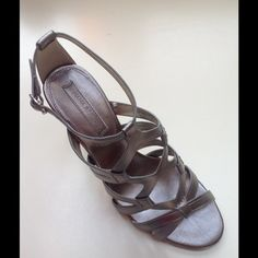 Pewter Banana Republic Janelle Sandals Matte shimmer pewter leather sandals, worn once. Ankle strap, sophisticated back detail, 3.5inch heel. Intricate woven leather detail down front.  Wear with jeans or dressier. Excellent condition. These have been reduced. Price firm unless bundled. I don't trade. Banana Republic Shoes Sandals