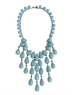 """Our items are custom made, please allow 2 weeks for delivery.Hand-made rhodium plated glass turquoise necklace. Worn on the set of the hit CW show, Gossip Girl!Tiers of luminous faceted glass turquoise teardrops fall in an elegant, cool cascade. Measures 22"""" long with an 18"""" neck circumference"""
