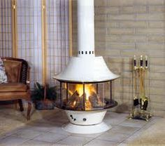 Malm Wood Spin-A-Fire Porcelain White with Black base. The Spin-A-Fire is designed and manufactured with Malm's highest quality for lasting beauty and excellent burning efficiency. Malm Spin-a-Fire. Freestanding Kitchen, Freestanding Fireplace, Wood Fireplace, Fireplace Design, Fireplace Kitchen, Fireplace Ideas, Brick Fireplaces, Modern Fireplaces, Stove Fireplace