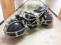 Students Working On Futuristic Looking Bike With Spherical Wheels