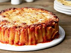 Rigatoni Pie - Turn traditional baked pasta on its head by standing each rigatoni noodle on its end. With just a few extra minutes of prep time, the classic dinner is transformed into an eye-catching pie that you can cut into wedges and serve. You might never take rigatoni another way. http://www.foodnetwork.com/recipes/food-network-kitchen/rigatoni-pie