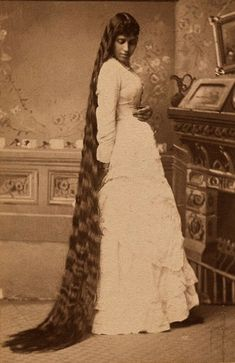 Raw material: a young Victorian woman displays her magnificent tresses.