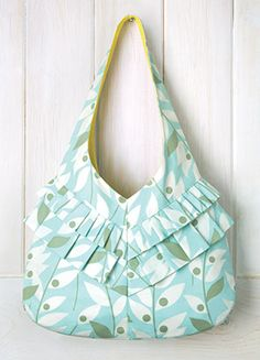 This charming and fashionable purse is a great bag for sewers and seamstresses at every level of sewing. Fashionable, easy, stylish and fun. We have sewing patterns and materials kits with the fabric you need for a Sweetheart Swing Bag by Heather Bailey.