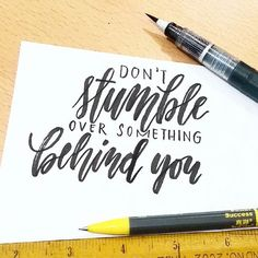 """Don't stumble over something behind you"" words to live by, hand lettering"
