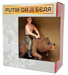 "Putin Riding on a Bear Action Figure. ""Memorabilia of the majestic Vladimir Putin Figurine depicts shirtless President Putin riding effortlessly on Russian bear."""