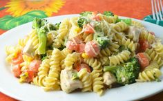 Chicken Voila Copycat—Tender chicken, crisp carrots, broccoli, and corn and rotini blanketed in a creamy Ranch sauce.