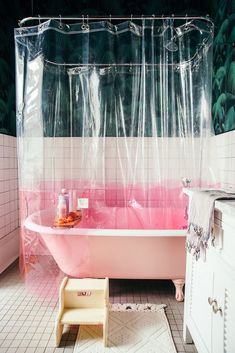 home in nola. pink and clear plastic shower curtain and pink clawfoot tub. / sfgirlbybaypink and clear plastic shower curtain and pink clawfoot tub.