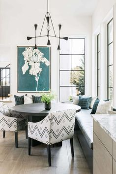Southern Beach House with Modern Interiors - Modern Breakfast Nook with black framed windows, modern chandelier and a large L-shape banquette Dining Nook, Dining Room Lighting, Dining Room Sets, Dining Room Design, Dining Room Table, Kitchen Lighting, Banquette Table, Table Bench, Dining Decor