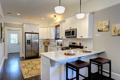 White-modern-G-shaped-Kitchen-layout-idea