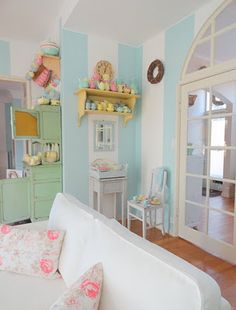 I've been wanting to paint an accent wall with aqua stripes...love this!