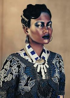 An Alberta Ferretti embroidered vest is worn over a Dries Van Noten blouse (driesvannoten.be).La Princessa World: African Print, Motifs, Tribal...Is the new Trend in High Fashion