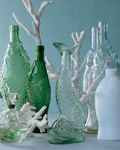 Vintage fish bottles with coral. Really good site for nautical decor.