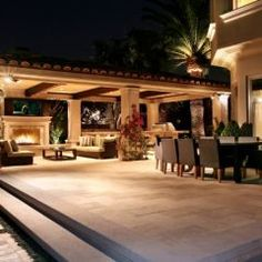 I like bringing the fireplace area under a roof, yet still outdoors. B'ful blend/contrast of indoor/outdoor/intimate/exposed.lighting complements it.
