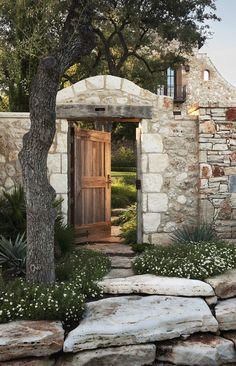 Stone fence (walled garden) with wooden door gate - so pretty #landscaping #yard #outdoor #design