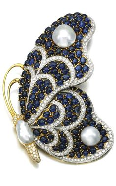 Cultured pearl, sapphire and diamond brooch Designed as a butterfly, set with baroque mabé cultured pearls, cabochon sapphires and brilliant-cut diamonds.