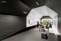 Gensler Completes Most Recent Office for Autodesk | Peel-and-stick stained-ash veneer and dry-erase paint line a hallway. #design #interiordesign #interiordesignmagazine #projects #offices @gensleron