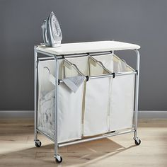 Free Shipping.  Shop Triple Laundry Sorter with Ironing Board.  Great for compact spaces, this dual-purpose laundry station provides a convenient place to sort and iron.