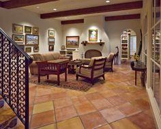 Den with terra cotta tile flooring in a Spanish Mediterranean Home in Dallas, Texas | Richard Drummond Davis Architects