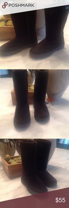 """BearPaw Brown Boots, 7, NWOB, See Comments 100% Suede     Imported     Dyed Sheep Fur (Fur Origin: China)     Rubber sole     Shaft measures approximately 8.5"""" from arch, although outside measurement is 9.5""""     Heel measures approximately 1""""     Boot opening measures approximately 13"""" around the inside, 16"""" on outside     Boot features insulated upper with shearling wo lining and wrap-around rubber sole   I ordered these in a 7 last summer. You need to go up a size in these as they are…"""