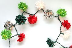 """Your holiday lights will be """"bow""""-tiful this year when you cover your tree lights in Christmas bows! Pretty tutorial from StudioDIY!"""