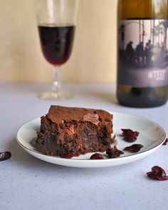 Fudgy, rich red wine brownies with drunken cranberries. The perfect adult dessert after a romantic dinner. Or you know, just because you can!