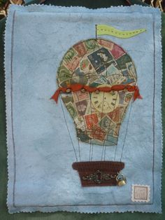 OOAK, handmade, mixed media, steam punk inspired Hot Air Balloon wall hanging.  Measuring 23cm x 30cm.  Pieces embellished onto hand dyed background & charms stitched onto repurposed stamp balloon.   *PLEASE NOTE* These wall hangings are not toys, they all contain small parts.