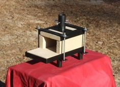 Propane Forge - Homemade forge fired by a propane burner. Frame is constructed from flat and angles bars with round pipe for the legs and burner tube. Fire bricks are lined with Plistix to enhance efficiency.