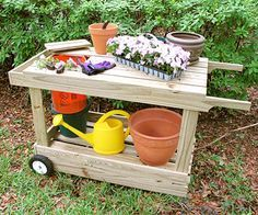 Portable Potting Bench...could try making this with old pallets!