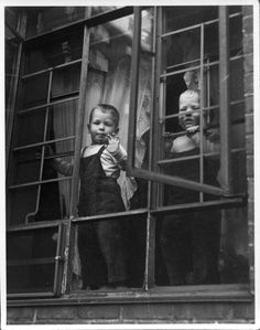 Before child safety bars!...........I grew up on the 11th floor...no guards! Yikes.................photo Vivian Maier
