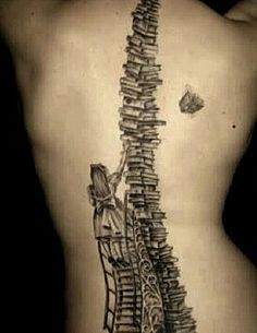 """So many books, So little time.."" Beautiful Alice in Wonderland back tattoo! C:"