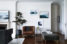masculine open plan living room with leather armchair
