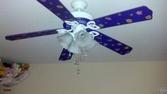 New ceiling fan in my daughters room spray painted purple.  We added flower scrapbook stickers and little jewels for an even more fancier look!