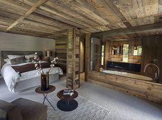 Wooden bedroom with big bath #chalet #alps #bedroom #bath #wooden #interior #design