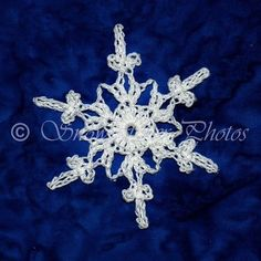 This is one of the final 20 snowflakes I made to finish off my dining room lamp last winter. I worked up the snowflake-covered rock durin...