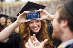 Holly Birchfield plays a trivia game with movie titles against a fellow graduate during commencement at University of California, Berkeley: