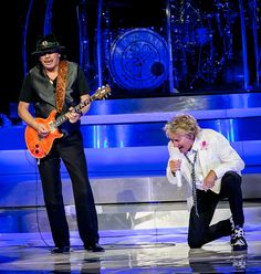 """Carlos Santana joins Rod Stewart on stage for """"I'd Rather Go Blind"""" at The Colosseum at Caesars Palace in Las Vegas, NV on May 6, 2014."""
