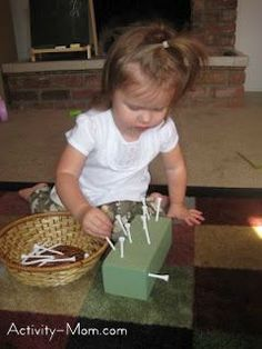 Golf tees in styrofoam :: Early Learning – Activities for My 1 Year Old | The Activity Mom