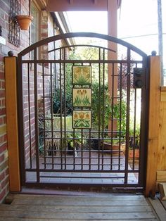 Custom wrought iron gate features Motawi Tile Wrought Iron Garden Gates, Garden Gates And Fencing, Fence Gate, Old Gates, Custom Gates, Classic Garden, Unique Doors, Backyard Patio, Outdoor Spaces