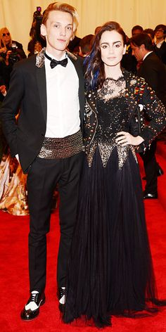 Lily Collins and Jamie Campbell Bower in Moschino.