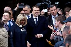 Founder and Leader of the political movement 'En Marche !' and presidential candidate Emmanuel Macron, center, and his wife Brigitte Trogneux go to vote for the second round of the election at the Town Hall on May 7, 2017 in Le Touquet-Paris-Plage, France. In this election race, Emmanuel Macron is opposed to far-right candidate Marine Le Pen. France is going to the polls on May 7 for the second round of the election which will decide their next President.